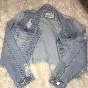 Light wash distressed jean jacket.